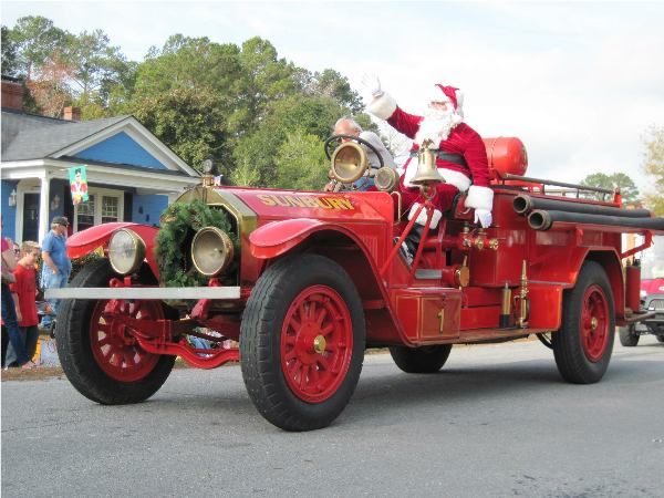 Santa Claus on Fire Truck in small town Christmas Parade